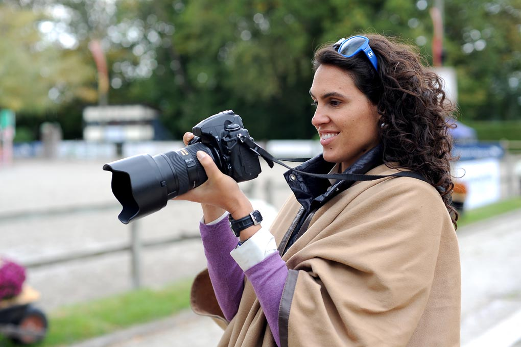 Woman learning photography technics by Oliver O'Hanlon